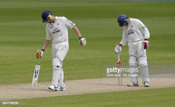 Lancashire's batsmen Andrew Flintoff and Stuart Law flatten out the Hampshire pitch the final day of their Liverpool Victoria County Championship...