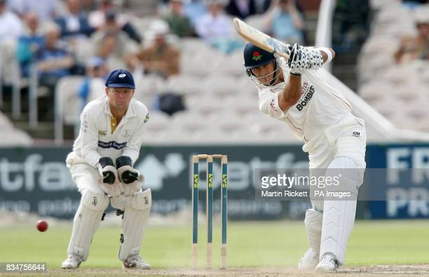 Lancashire's Francois Du Plessis hits out during the LV County Championship match at Old Trafford Cricket Manchester