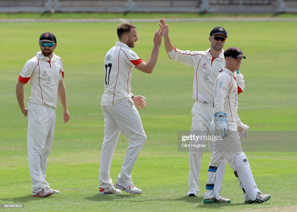 Lancashire's Kyle Jarvis (2 L) celebrates after he takes the wicket of Hampshire's Jimmy Adams of during day one of the Specsavers County Championship game between Lancashire and Hampshire at Old Trafford on June 19, 2017 in Manchester, England.