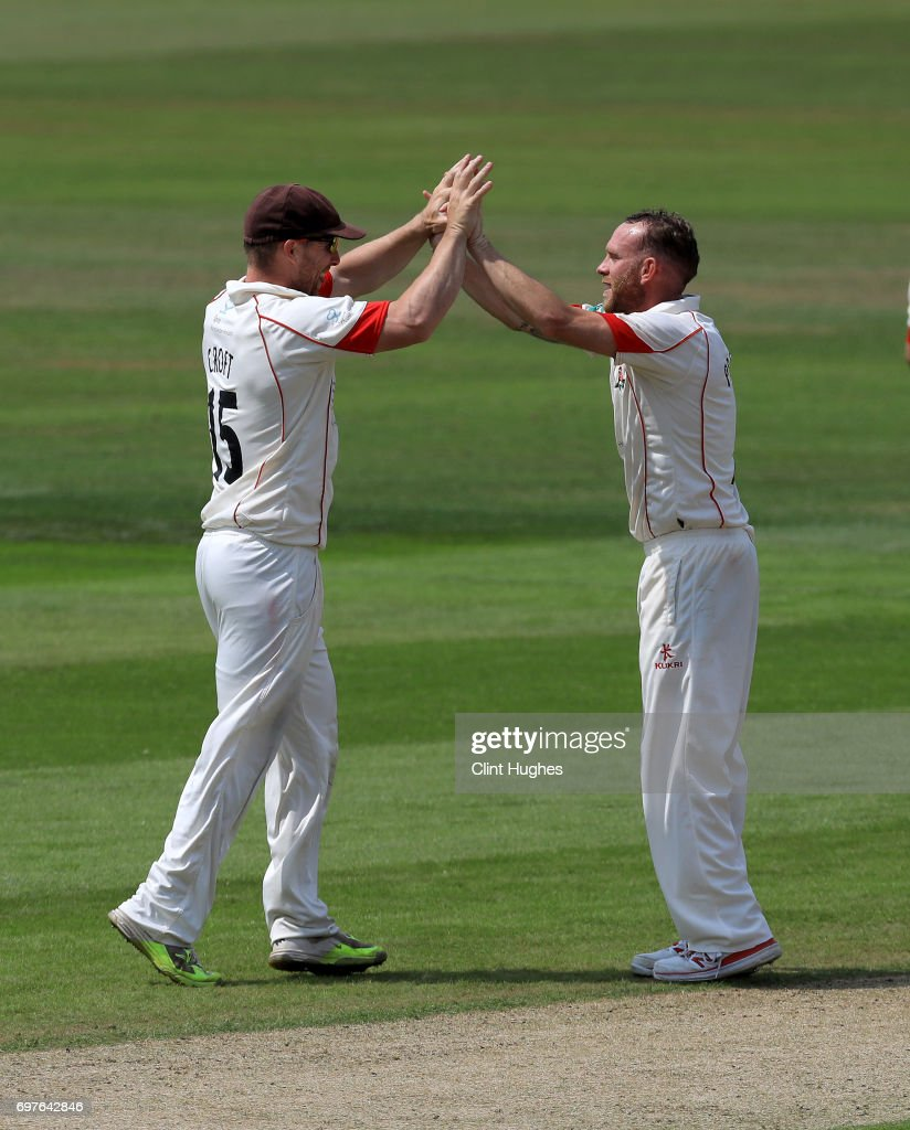Lancashire's Luke Procter (R) celebrates with team-mate Stephen Croft after he takes the wicket of Hampshire's James Vince during day one of the Specsavers County Championship game between Lancashire and Hampshire at Old Trafford on June 19, 2017 in Manchester, England.