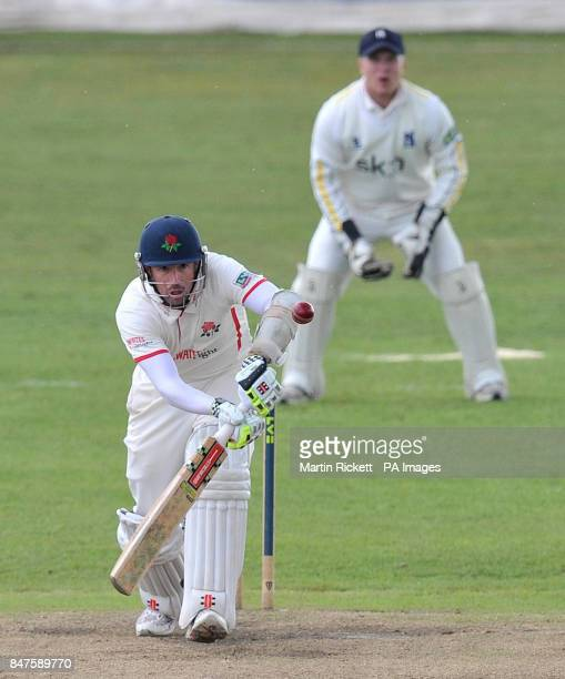 Lancashire's Paul Horton play defensibly watched by Warwickshire wicket keeper Tim Ambrose during the LV County Championship Division One match at...