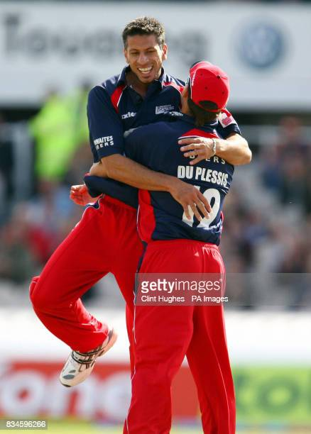 Lancashire's Sajid Mahmood celebrates with Francois Du Plessis after taking the wicket of Yorkshire's Michael Vaughan during the Twenty20 Cup match...