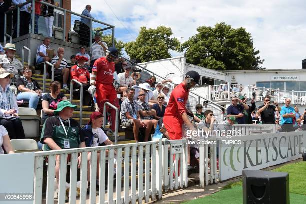 Lancashire's Tom Smith and Ashwell Prince walk down the steps and out onto the pitch to bat
