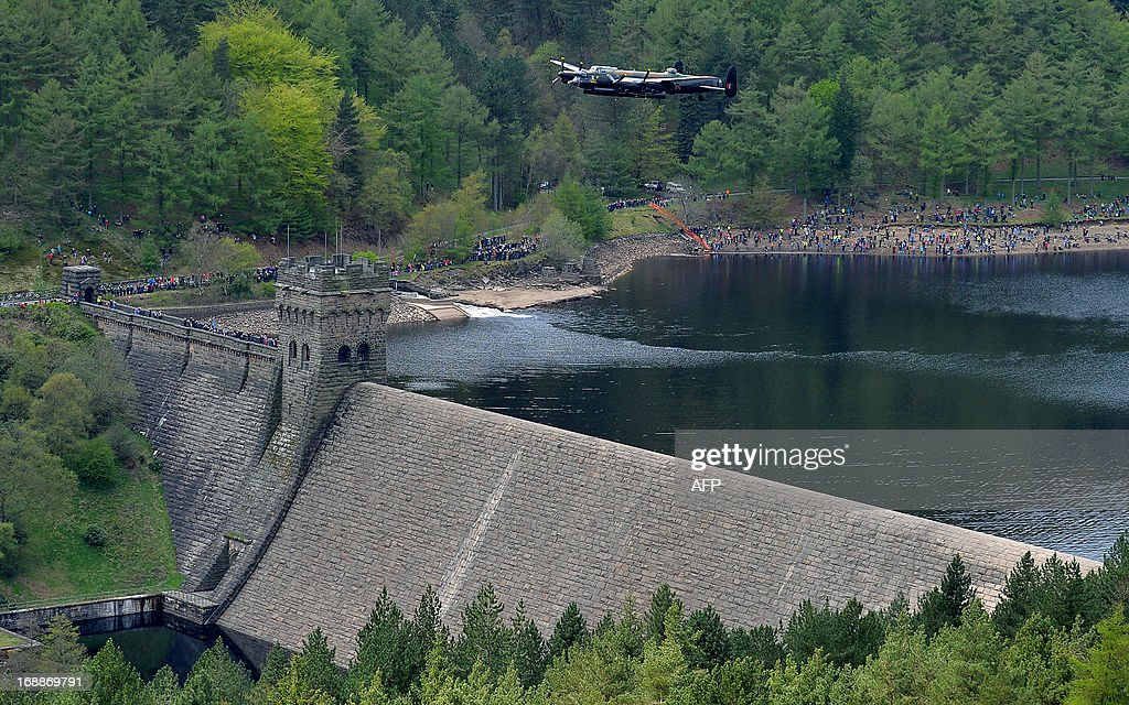A Lancaster bomber flies over Derwent Reservoir in Derbyshire, England on May 16, 2013, as part of events marking the 70th Anniversary of an air-raid on three dams in Germany's Ruhr Valley by a team of airmen dubbed the 'Dambusters'. A British World War II Lancaster bomber performed a flypast Thursday over a reservoir used for practice runs by the legendary 'Dambusters' airmen to mark 70 years since their daring raid over Nazi Germany's industrial heartland. The four-engined aircraft was joined by two Spitfires and two modern-day Tornado jets as they swept over the Derwent Reservoir in Derbyshire, northern England, where the Royal Air Force trialled the 'bouncing bomb'.