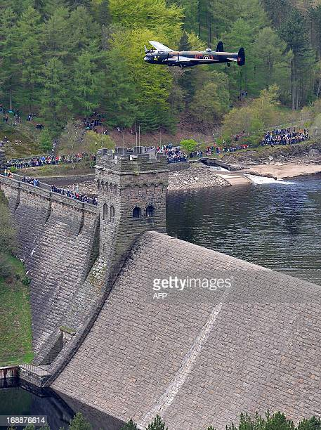 A Lancaster bomber flies over Derwent Reservoir in Derbyshire England on May 16 as part of events marking the 70th Anniversary of an airraid on three...