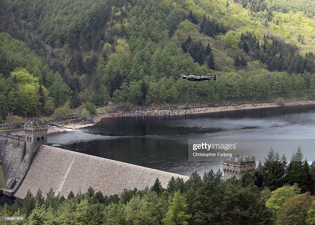 A Lancaster bomber flies over Ladybower reservoir in the Derbyshire Peak District to mark the 70th anniversary of the World War II Dambusters mission on May 16, 2013 in Derwent, England. Ladybower and Derwent reservoirs were used by the RAF's 617 Squadron in 1943 to test Sir Barnes Wallis' bouncing bomb before their mission to destroy dams in Germany's Ruhr Valley. Today marks the 70th anniversary of the famous Dambuster mission and will be watched by veterans from the original campaign.