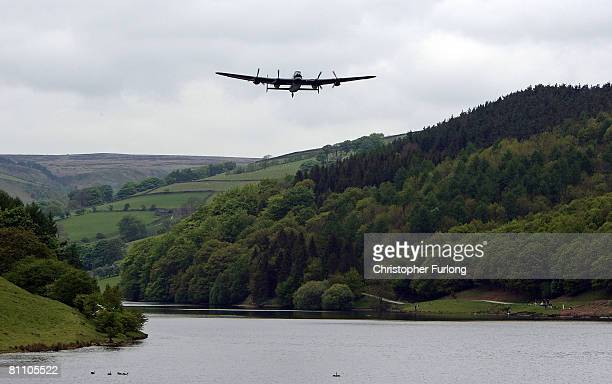 Lancaster bomber flies over Ladybower reservoir in the Derbyshire Peak District to mark the 65th anniversary of the World War II Dambusters mission...