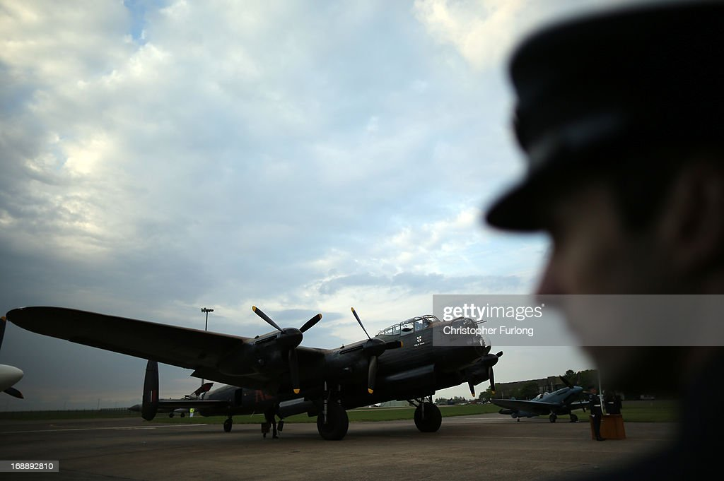 Lancaster Bomber 'The City of Lincoln' sits on the runway as it takes part in a Sunset Ceremony to mark the 70th anniversary of the World War II Dambusters mission at RAF Sccampton on May 16, 2013 in Lincoln, England. Ladybower and Derwent reservoirs were used by the RAF's 617 Squadron in 1943 to test Sir Barnes Wallis' bouncing bomb before their mission to destroy dams in Germany's Ruhr Valley. Today marks the 70th anniversary of the famous Dambuster mission and will be watched by veterans from the original campaign.