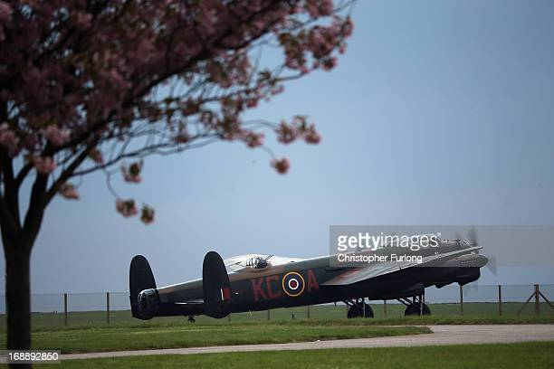 Lancaster Bomber 'The City of Lincoln' taxis on the runway as it takes part in a Sunset Ceremony to mark the 70th anniversary of the World War II...