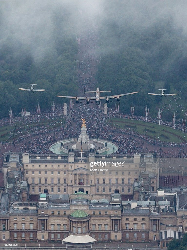 A Lancaster is flanked by two Spitfires of the Battle of Britain Memorial Flight fly over Buckingham Palace as part of Her Majesty The Queen's Birthday Flypast during Trooping the Colour on June 14, 2014 in London, England.