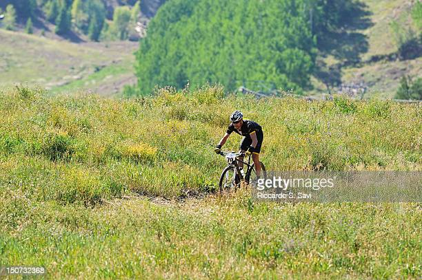 Lance Armstrong finishes the Power of Four Mountain Bike Race on Aspen Mountain on August 25 2012 in Aspen Colorado