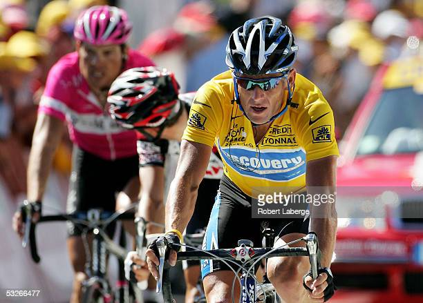 Lance Armstrong of the US and riding for the Discovery Channel cycling team crosses the finish line in the yellow jersey ahead of Ivan Baso of Italy...