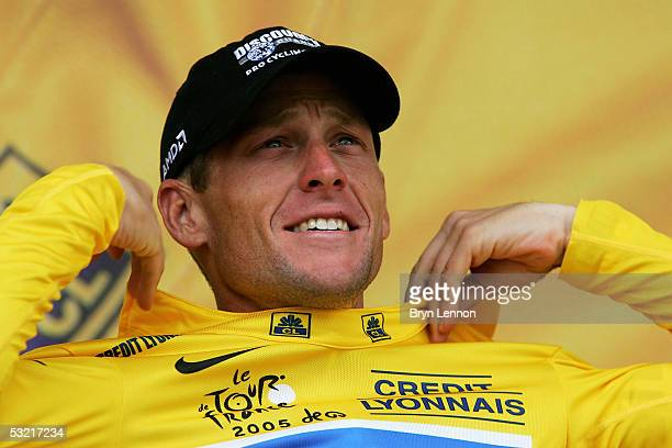 Lance Armstrong of the US and The Discovery Channel team retains the yellow jersey on the podium after Stage 8 of the 92nd Tour de France between...