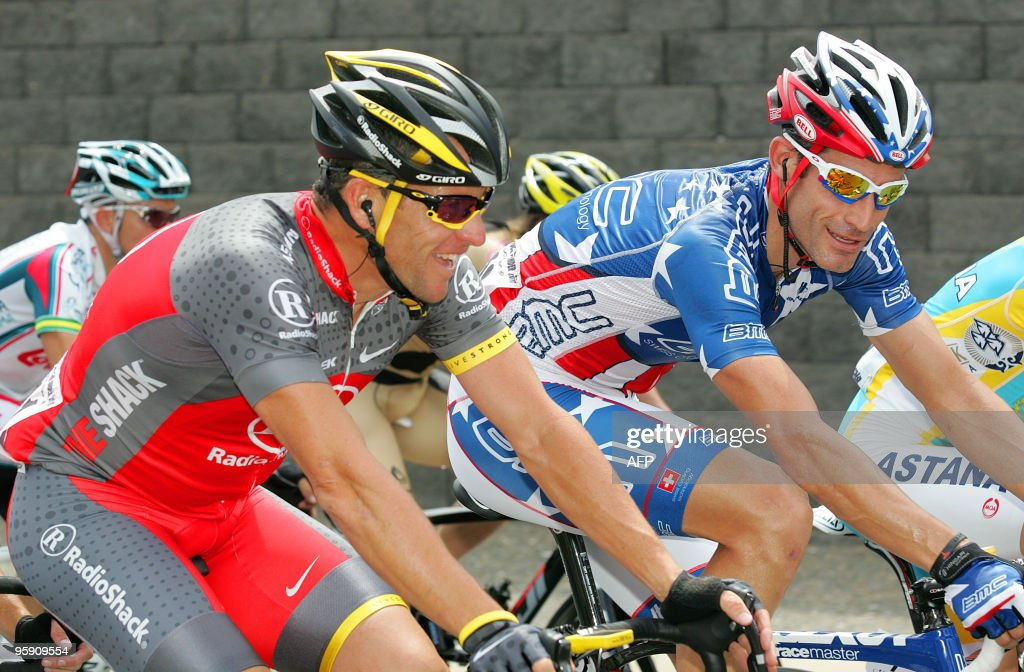 Lance Armstrong (L) of the US talks with George Hincapie (R) during the stage three Unley to Stirling leg of the Tour Down Under cycling race in Adelaide on January 21, 2010. The Tour Down Under is held from January 17-24. AFP PHOTO / Mark GUNTER
