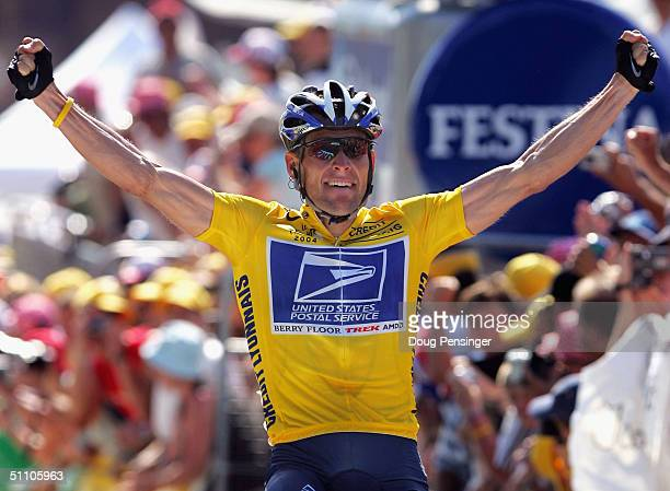 Lance Armstrong of the USA and riding for US Postal Service presented by Berry Floor celebrates as he wins stage 17 of the Tour de France on July 22...