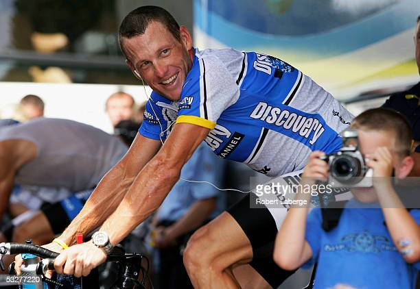 Lance Armstrong of the USA riding for the Discovery Channel cycling team warms up before the start of the Individual Time Trial as his son Luke takes...