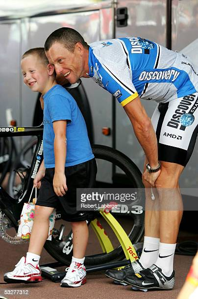 Lance Armstrong of the USA riding for the Discovery Channel cycling team talks with his son Luke before the Individual Time Trial stage 20 of the...