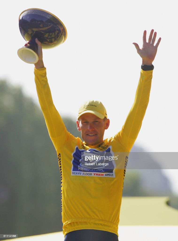 <a gi-track='captionPersonalityLinkClicked' href=/galleries/search?phrase=Lance+Armstrong&family=editorial&specificpeople=203072 ng-click='$event.stopPropagation()'>Lance Armstrong</a> of the USA riding for the US Postal Service team presented by Berry Floor, celebrates on the podium after winning a sixth consecutive Yellow Jersey during Stage 20 of the Tour de France between Montereau and The Champs Elysees on July 25, 2004 in Paris, France.(Photo by Robert Laberge/Getty Images).