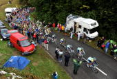 Lance Armstrong of USA and team Astana rides with the peloton during stage 14 of the 2009 Tour de France from Colmar to Besancon on July 18 2009 in...