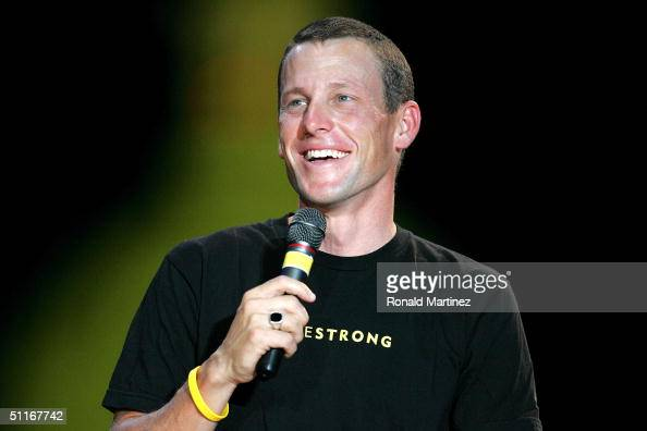 Lance Armstrong smiles while speaking to the crowd during a celebration in his honor on August 13 2004 in front of the Texas State Capitol in Austin...