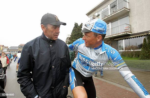 Lance Armstrong talks with former Belgian cycling champion Eddy Merckx prior to the start of the Fleche Brabanconne race in Zavantem 27 March 2005...