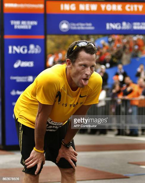 Lance Armstrong who retired from cycling after winning an unprecedented seven straight Tour de France sticks his tongue out as he crosses the finish...