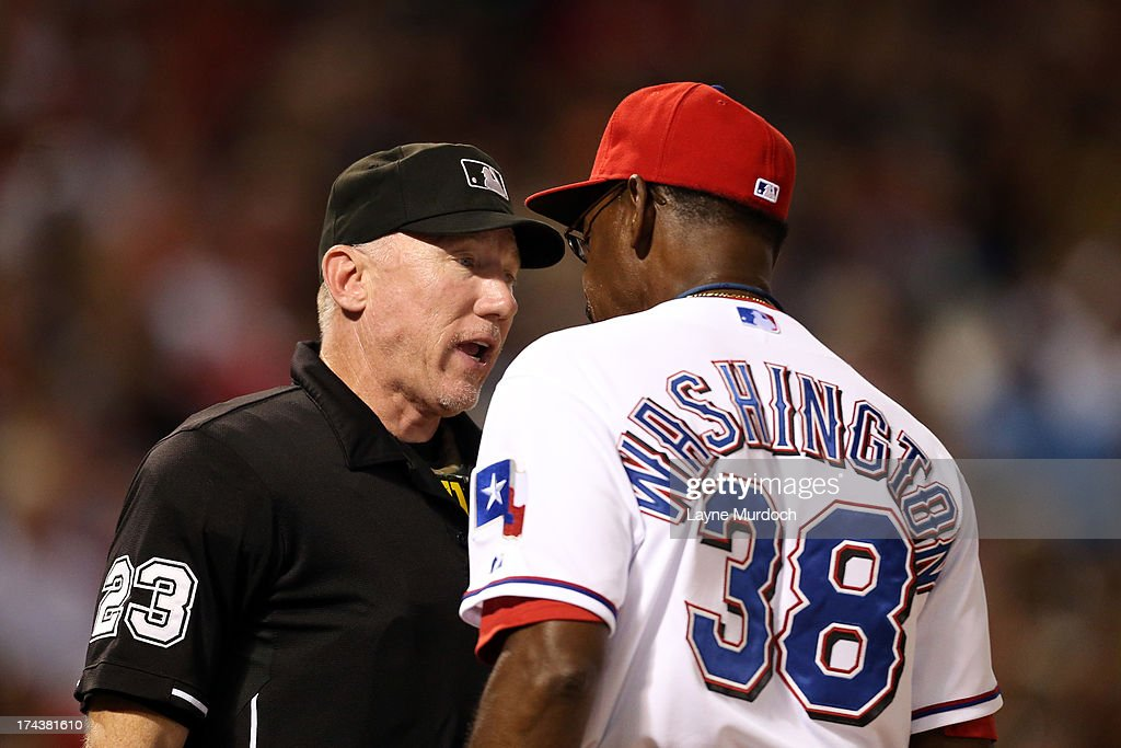Lance Barksdale #23, an umpire has a conversation with Ron Washington, manager of the Texas Rangers during a game against the New York Yankees on July 24, 2013 at the Rangers Ballpark in Arlington in Arlington, Texas.