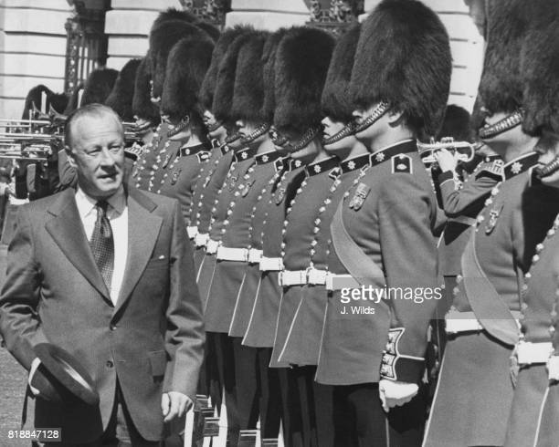 Lance Barnard the Australian Minister of Defence inspects a Guard of Honour of 2nd Battalion Coldstream Guards at the Ministry of Defence in London...