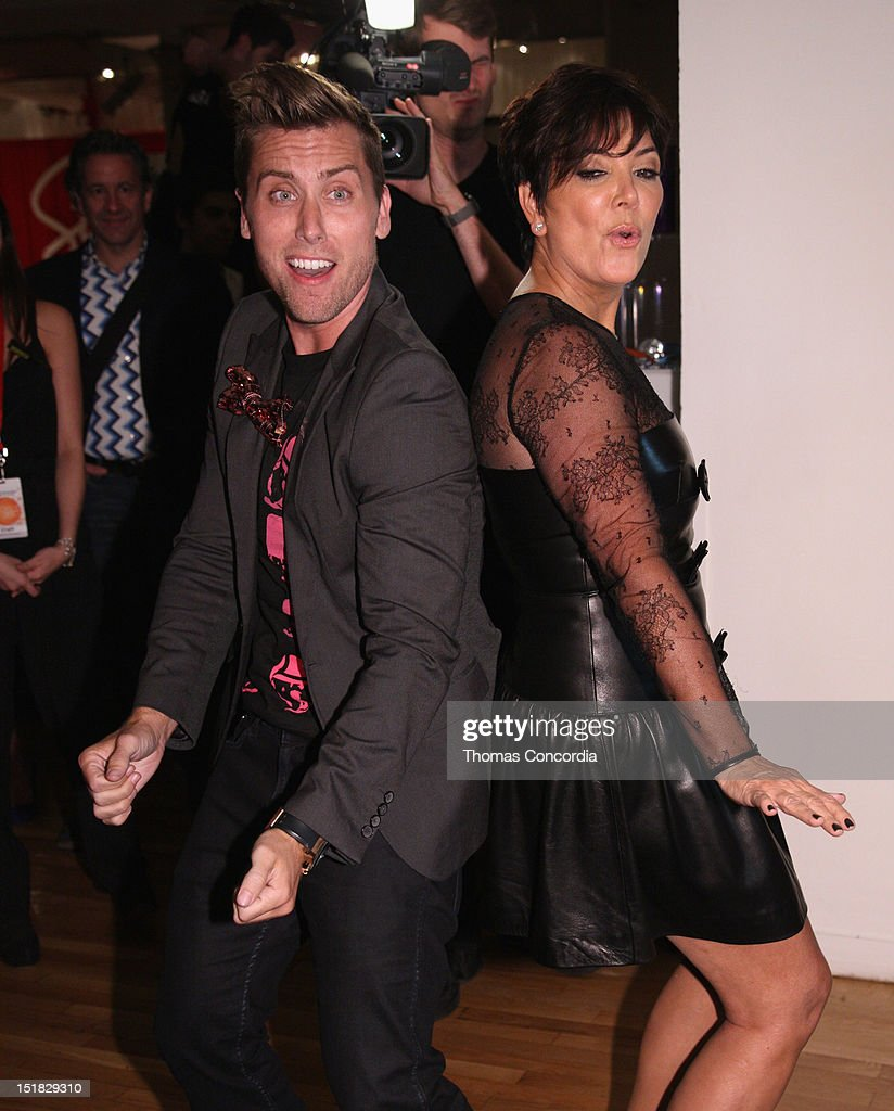 Lance Bass and Kris Jenner arrive at the Tumbler and Tipsy by Michael Kuluva fashion show presented by UbiSoft's 'Just Dance 4' at STYLE360 in the...