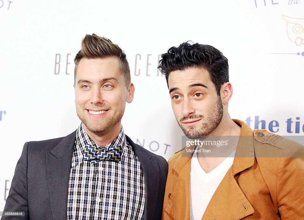 <a gi-track='captionPersonalityLinkClicked' href=/galleries/search?phrase=Lance+Bass&family=editorial&specificpeople=210566 ng-click='$event.stopPropagation()'>Lance Bass</a> (L) and Michael Turchin arrive at the 'Tie The Knot' pop-up store opening held at The Beverly Center on December 5, 2013 in Los Angeles, California.