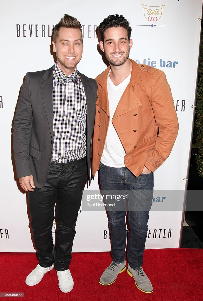 <a gi-track='captionPersonalityLinkClicked' href=/galleries/search?phrase=Lance+Bass&family=editorial&specificpeople=210566 ng-click='$event.stopPropagation()'>Lance Bass</a> (L) and Michael Turchin arrive at 'Tie The Knot' Store Grand Opening with founder Jesse Tyler Ferguson at The Beverly Center on December 5, 2013 in Los Angeles, California.