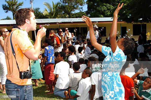 Lance Bass blows bubbles with village children during Kelly Slater Invitational Fiji Day 2 Mome Village Tour in Mome Village Tavarua Island Fiji