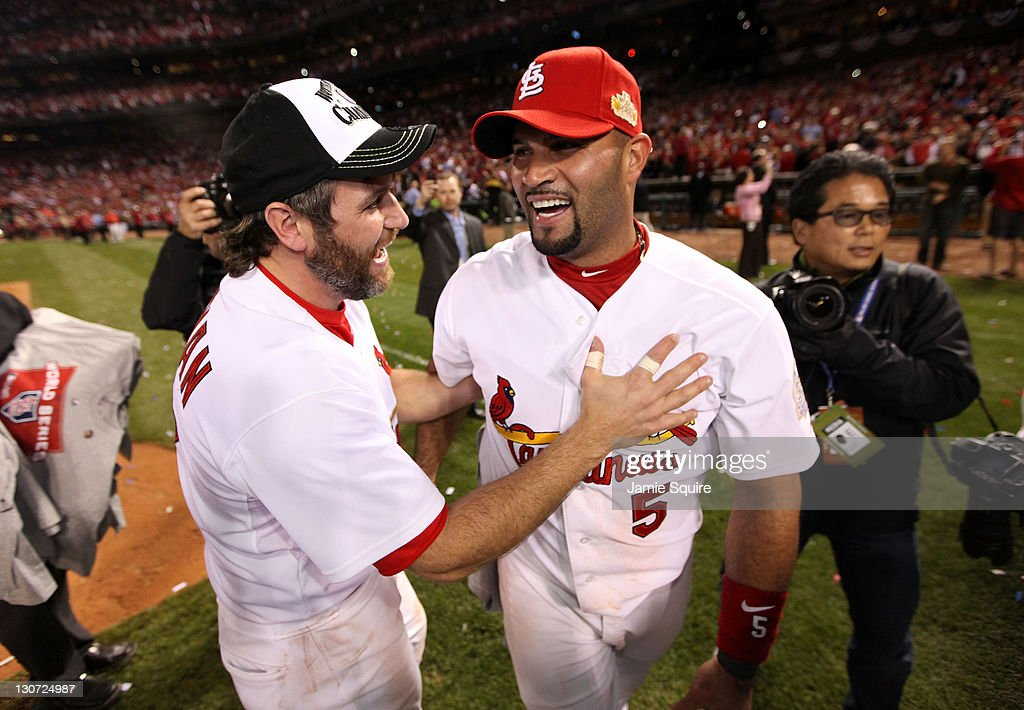 <a gi-track='captionPersonalityLinkClicked' href=/galleries/search?phrase=Lance+Berkman&family=editorial&specificpeople=167176 ng-click='$event.stopPropagation()'>Lance Berkman</a> #12 and <a gi-track='captionPersonalityLinkClicked' href=/galleries/search?phrase=Albert+Pujols&family=editorial&specificpeople=171151 ng-click='$event.stopPropagation()'>Albert Pujols</a> #5 of the St. Louis Cardinals celebrate after defeating the Texas Rangers 6-2 to win the World Series in Game Seven of the MLB World Series at Busch Stadium on October 28, 2011 in St Louis, Missouri.