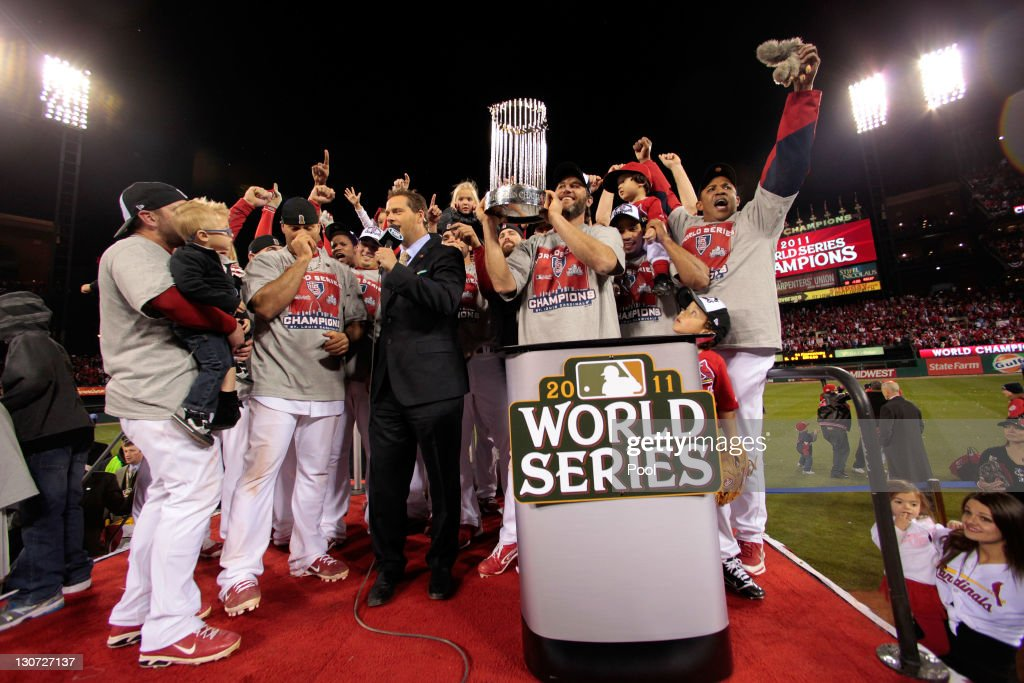 <a gi-track='captionPersonalityLinkClicked' href=/galleries/search?phrase=Lance+Berkman&family=editorial&specificpeople=167176 ng-click='$event.stopPropagation()'>Lance Berkman</a> #12 and the St. Louis Cardinals celebrate with the World Series trophy after defeating the Texas Rangers 6-2 to win the World Series in Game Seven of the MLB World Series at Busch Stadium on October 28, 2011 in St Louis, Missouri.