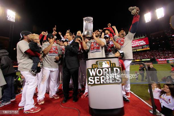 Lance Berkman and the St Louis Cardinals celebrate with the World Series trophy after defeating the Texas Rangers 62 to win the World Series in Game...