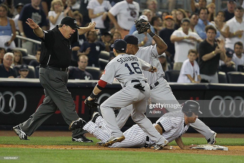 <a gi-track='captionPersonalityLinkClicked' href=/galleries/search?phrase=Lance+Berkman&family=editorial&specificpeople=167176 ng-click='$event.stopPropagation()'>Lance Berkman</a> #17 of the New York Yankees is safe at third as <a gi-track='captionPersonalityLinkClicked' href=/galleries/search?phrase=Marco+Scutaro&family=editorial&specificpeople=239523 ng-click='$event.stopPropagation()'>Marco Scutaro</a> #16 of the Boston Red Sox is late with the tag in the fifth inning during their game on August 8, 2010 at Yankee Stadium in the Bronx borough of New York City.