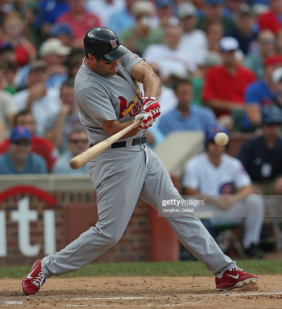 <a gi-track='captionPersonalityLinkClicked' href=/galleries/search?phrase=Lance+Berkman&family=editorial&specificpeople=167176 ng-click='$event.stopPropagation()'>Lance Berkman</a> #12 of the St. Louis Cardinals hits a solo home run against the Chicago Cubs in the 3rd inning at Wrigley Field on July 27, 2012 in Chicago, Illinois.