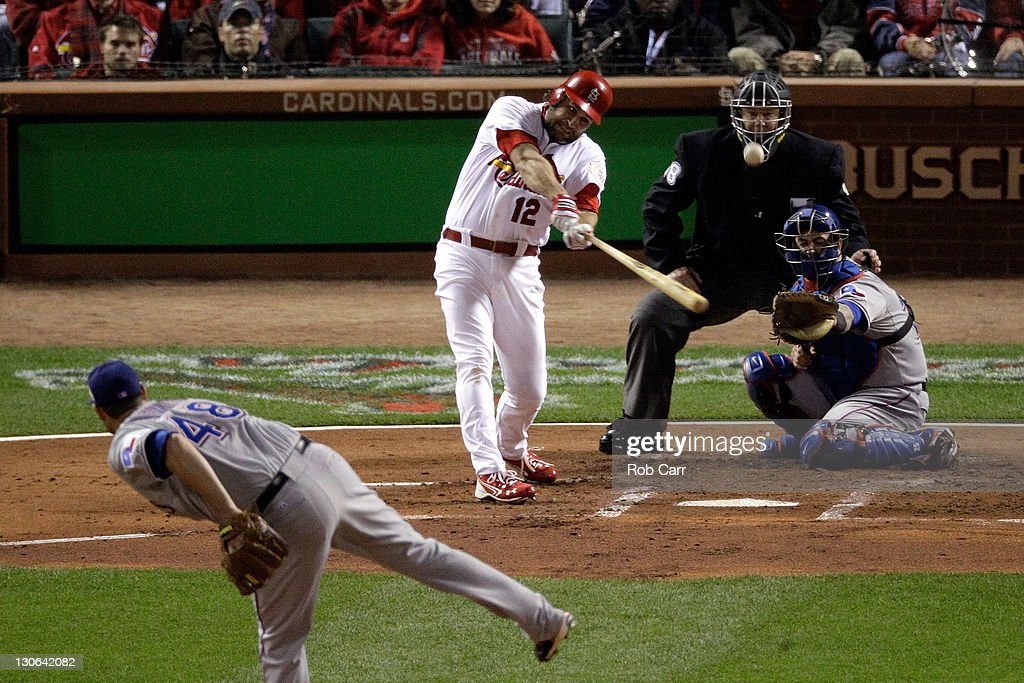 <a gi-track='captionPersonalityLinkClicked' href=/galleries/search?phrase=Lance+Berkman&family=editorial&specificpeople=167176 ng-click='$event.stopPropagation()'>Lance Berkman</a> #12 of the St. Louis Cardinals hits a two-run home run in the first inning off of <a gi-track='captionPersonalityLinkClicked' href=/galleries/search?phrase=Colby+Lewis&family=editorial&specificpeople=834318 ng-click='$event.stopPropagation()'>Colby Lewis</a> #48 of the Texas Rangers during Game Six of the MLB World Series at Busch Stadium on October 27, 2011 in St Louis, Missouri.