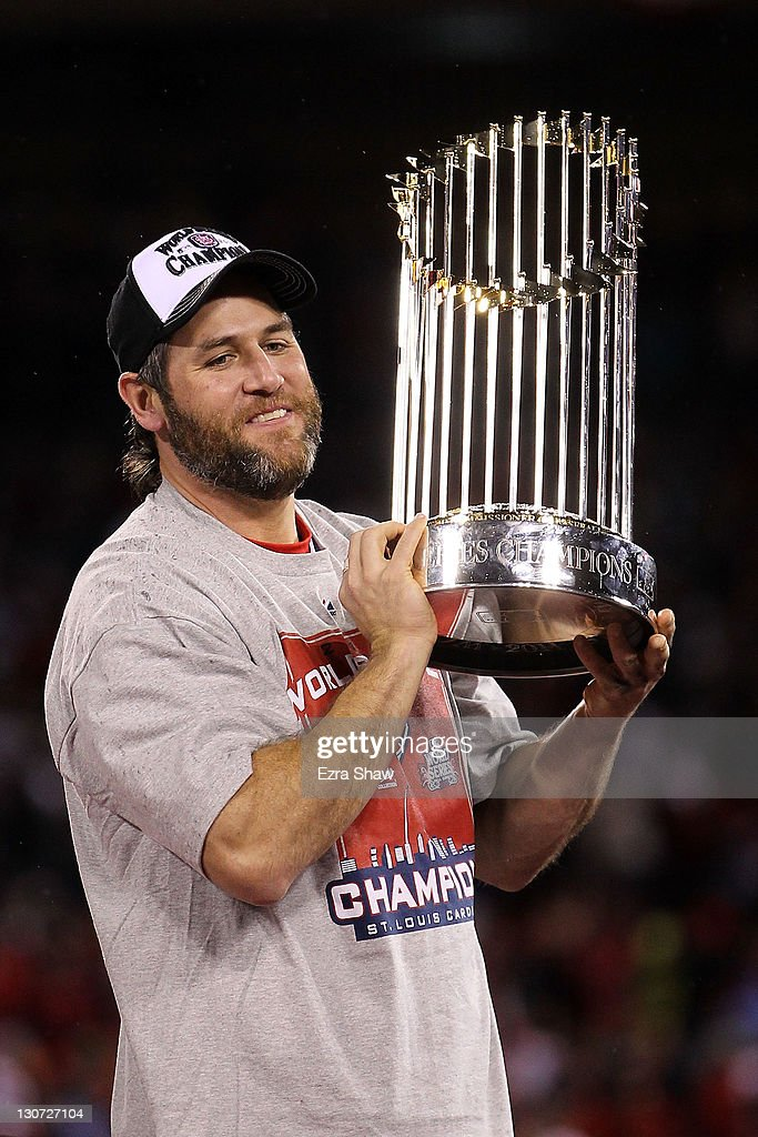 <a gi-track='captionPersonalityLinkClicked' href=/galleries/search?phrase=Lance+Berkman&family=editorial&specificpeople=167176 ng-click='$event.stopPropagation()'>Lance Berkman</a> #12 of the St. Louis Cardinals holds up the World Series trophy after defeating the Texas Rangers 6-2 in Game Seven of the MLB World Series at Busch Stadium on October 28, 2011 in St Louis, Missouri.
