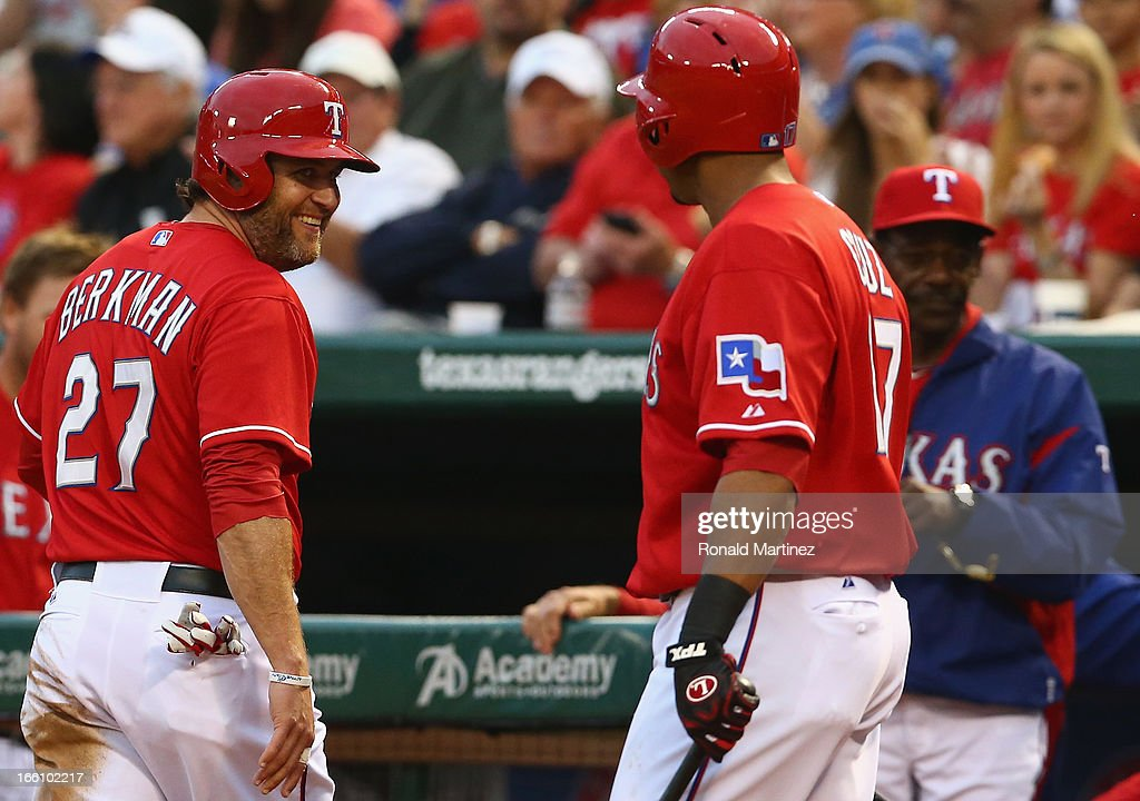 <a gi-track='captionPersonalityLinkClicked' href=/galleries/search?phrase=Lance+Berkman&family=editorial&specificpeople=167176 ng-click='$event.stopPropagation()'>Lance Berkman</a> #27 of the Texas Rangers celebrates a run with <a gi-track='captionPersonalityLinkClicked' href=/galleries/search?phrase=Nelson+Cruz&family=editorial&specificpeople=235459 ng-click='$event.stopPropagation()'>Nelson Cruz</a> #17 of the Texas Rangers at Rangers Ballpark in Arlington on April 8, 2013 in Arlington, Texas.