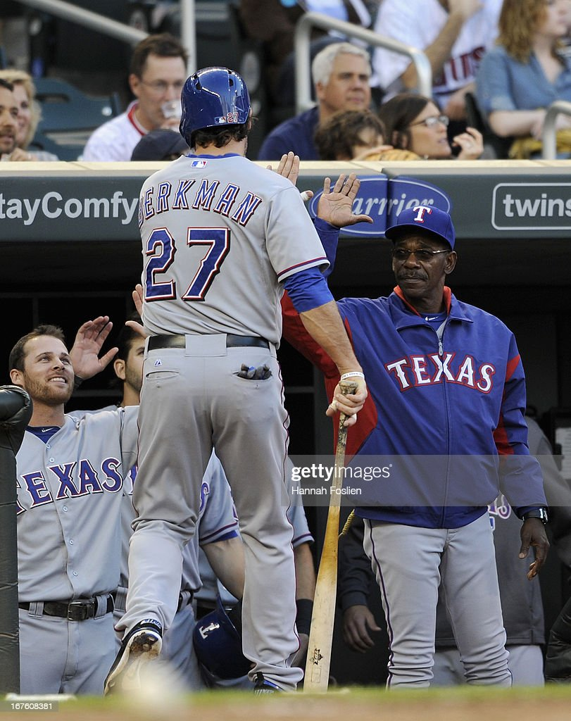 <a gi-track='captionPersonalityLinkClicked' href=/galleries/search?phrase=Lance+Berkman&family=editorial&specificpeople=167176 ng-click='$event.stopPropagation()'>Lance Berkman</a> #27 of the Texas Rangers celebrates scoring a run against the Minnesota Twins during the first inning of the game on April 26, 2013 at Target Field in Minneapolis, Minnesota.