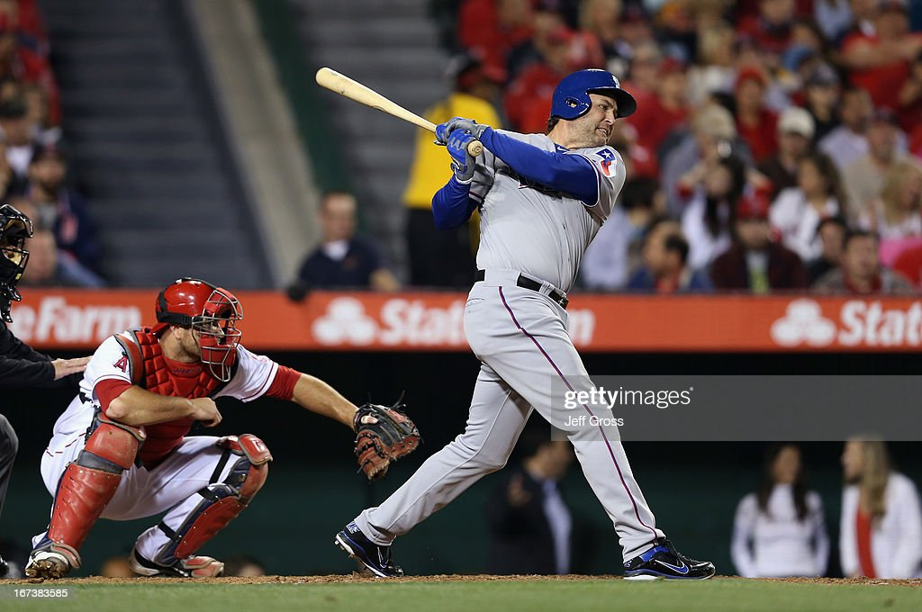 <a gi-track='captionPersonalityLinkClicked' href=/galleries/search?phrase=Lance+Berkman&family=editorial&specificpeople=167176 ng-click='$event.stopPropagation()'>Lance Berkman</a> #27 of the Texas Rangers hits a base hit that scores two runs in the fourth inning against the Los Angeles Angels of Anaheim at Angel Stadium of Anaheim on April 24, 2013 in Anaheim, California.