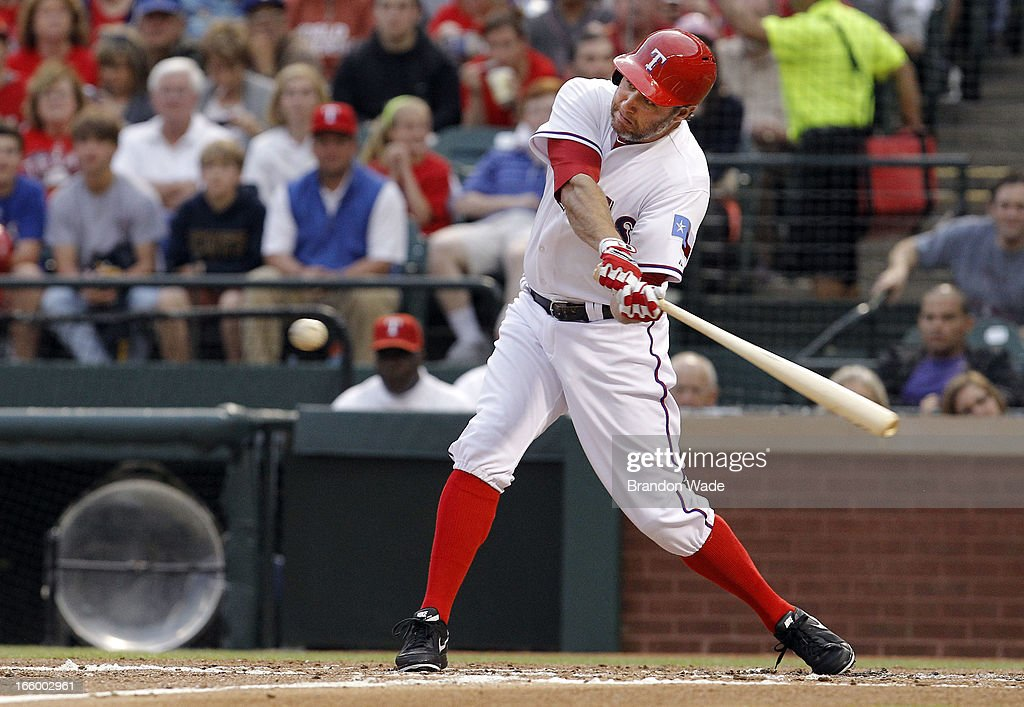 <a gi-track='captionPersonalityLinkClicked' href=/galleries/search?phrase=Lance+Berkman&family=editorial&specificpeople=167176 ng-click='$event.stopPropagation()'>Lance Berkman</a> #27 of the Texas Rangers hits a solo home run in the first inning against the Los Angeles Angels of Anaheim at Rangers Ballpark in Arlington on April 7, 2013 in Arlington, Texas.