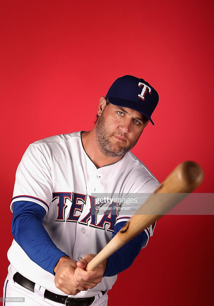 Lance Berkman #27 of the Texas Rangers poses for a portrait during spring training photo day at Surprise Stadium on February 20, 2013 in Surprise, Arizona.