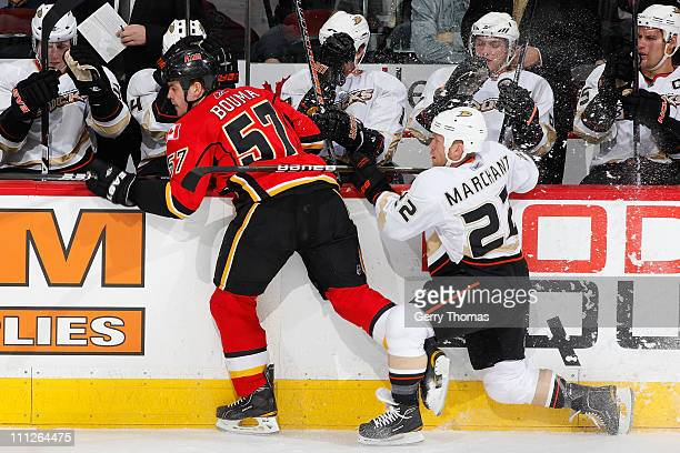 Lance Bouma of the Calgary Flames battles along the boards against Todd Marchant of the Anaheim Ducks on March 30 2011 at the Scotiabank Saddledome...