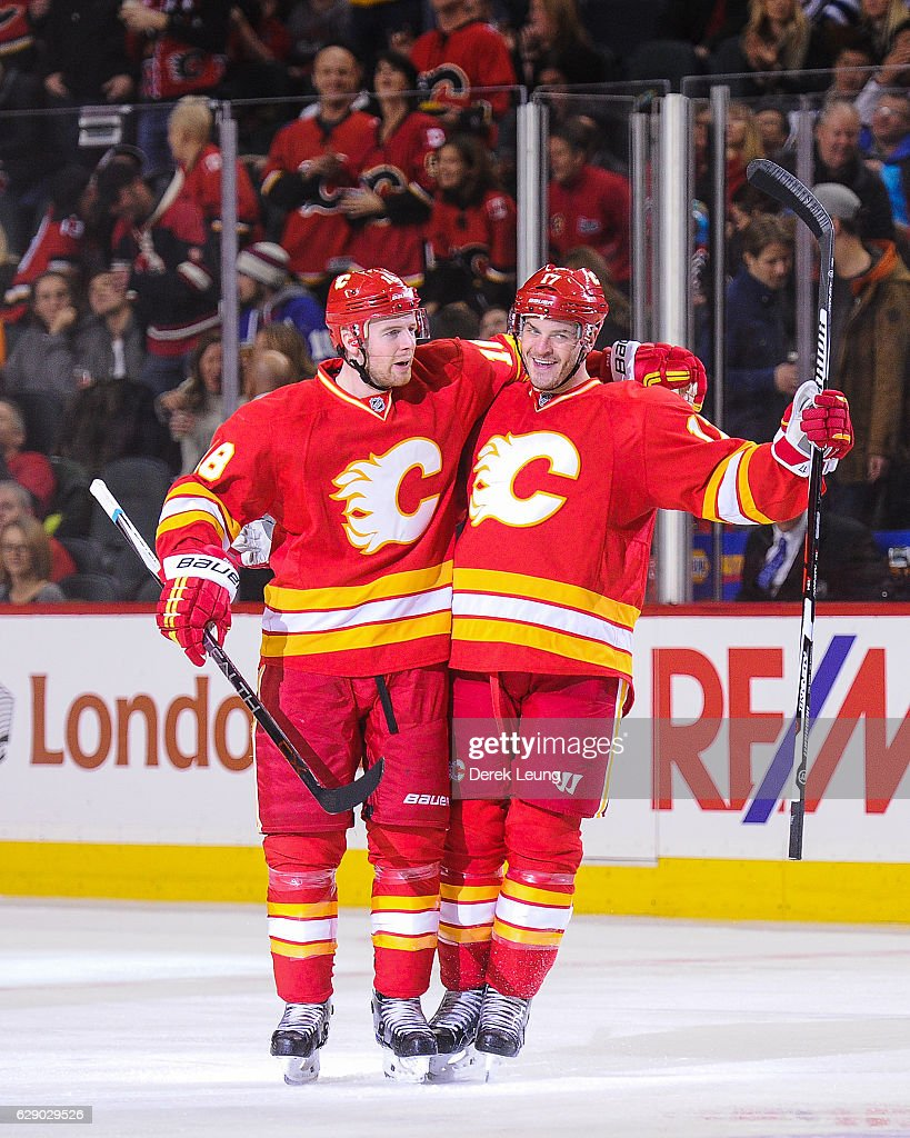 Lance Bouma #17 of the Calgary Flames celebrates with his teammate Matt Stajan #18 after scoring against the Winnipeg Jets during an NHL game at Scotiabank Saddledome on December 10, 2016 in Calgary, Alberta, Canada.