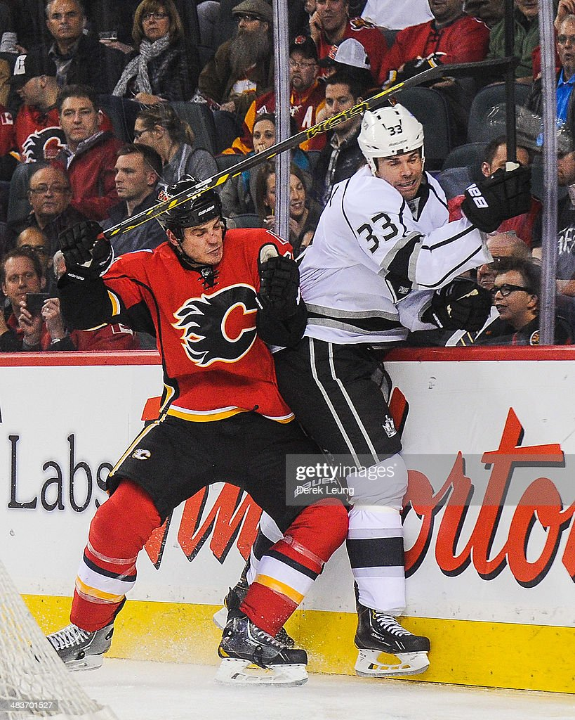<a gi-track='captionPersonalityLinkClicked' href=/galleries/search?phrase=Lance+Bouma&family=editorial&specificpeople=4303790 ng-click='$event.stopPropagation()'>Lance Bouma</a> #17 of the Calgary Flames checks <a gi-track='captionPersonalityLinkClicked' href=/galleries/search?phrase=Willie+Mitchell+-+Ice+Hockey+Player&family=editorial&specificpeople=12876291 ng-click='$event.stopPropagation()'>Willie Mitchell</a> #33 of the Los Angeles Kings during an NHL game at Scotiabank Saddledome on April 9, 2014 in Calgary, Alberta, Canada. The Flames defeated the Kings 4-3 in shootout.