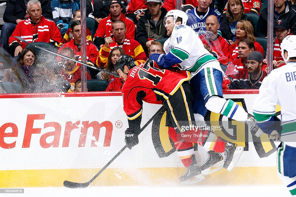 <a gi-track='captionPersonalityLinkClicked' href=/galleries/search?phrase=Lance+Bouma&family=editorial&specificpeople=4303790 ng-click='$event.stopPropagation()'>Lance Bouma</a> #17 of the Calgary Flames is checked by <a gi-track='captionPersonalityLinkClicked' href=/galleries/search?phrase=Ryan+Stanton&family=editorial&specificpeople=7184071 ng-click='$event.stopPropagation()'>Ryan Stanton</a> #18 of the Vancouver Canucks at Scotiabank Saddledome on October 6, 2013 in Calgary, Alberta, Canada.