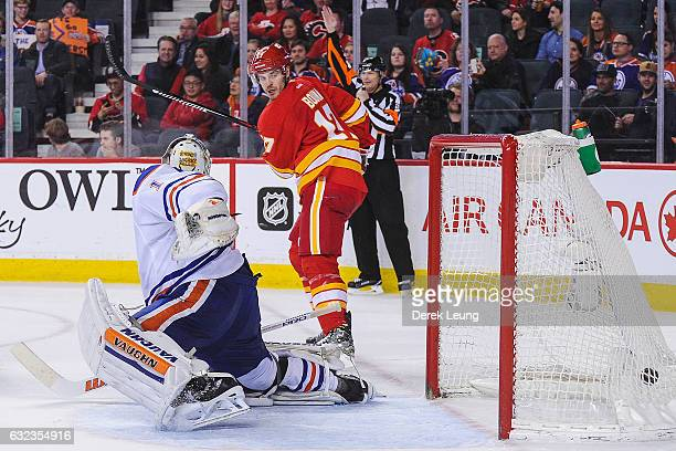 Lance Bouma of the Calgary Flames scores against Laurent Brossoit of the Edmonton Oilers during an NHL game at Scotiabank Saddledome on January 21...