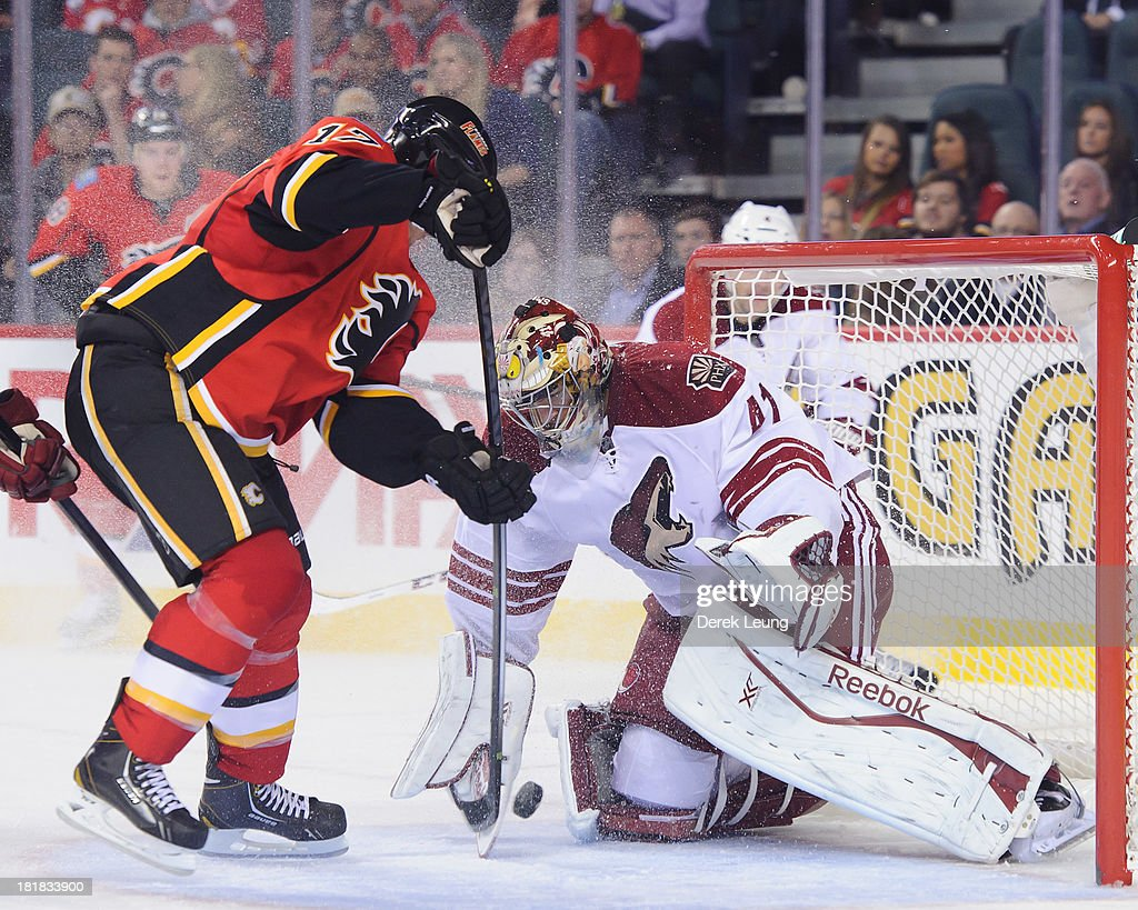 <a gi-track='captionPersonalityLinkClicked' href=/galleries/search?phrase=Lance+Bouma&family=editorial&specificpeople=4303790 ng-click='$event.stopPropagation()'>Lance Bouma</a> #17 of the Calgary Flames shoots the puck past the defence of Mike Smith #41 of the Phoenix Coyotes during a preseason NHL game at Scotiabank Saddledome on September 25, 2013 in Calgary, Alberta, Canada.